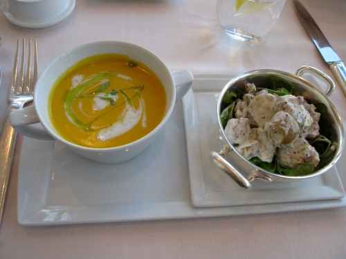 Coconut and pumpkin soup with potato salad