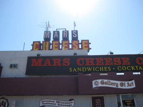 The sun shines over the Mars Cheese Castle sign, an I-94 landmark