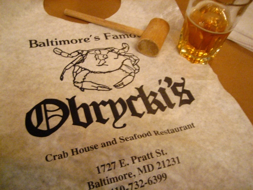 The Obrycki's bib, wooden mallet and house lager