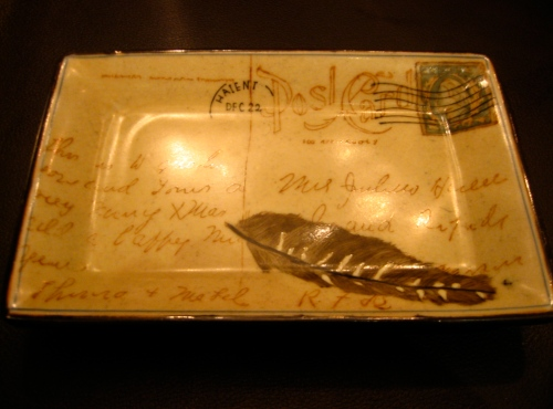 The bill at Sepia comes on one of these postcard trays