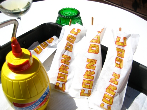 Hand-dipped corn dogs on the patio at Juicy